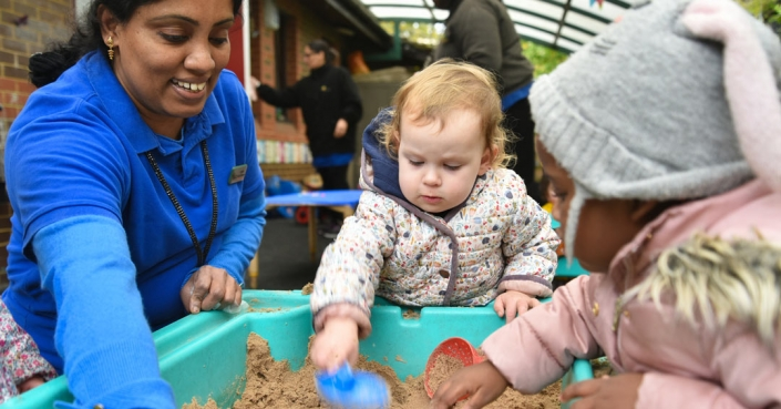 Under fives play with sand