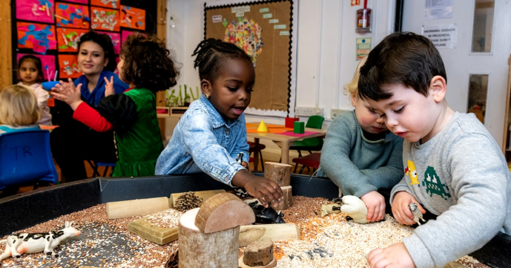 Children playing & learning, using multiple materials and textures