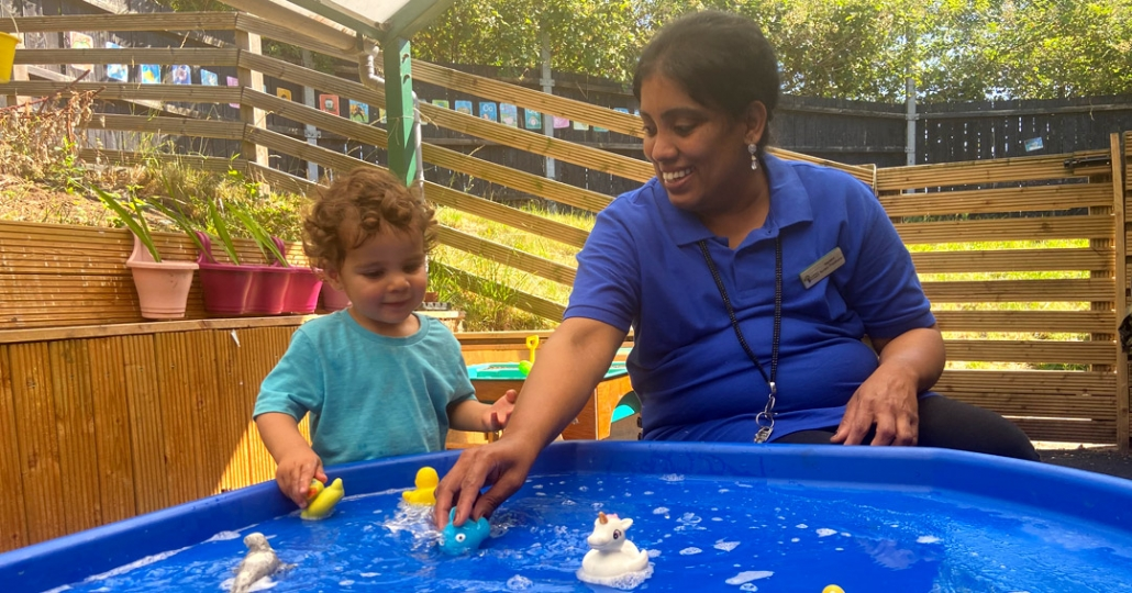 Safe play involving water, outside at Treetops Nursery, Willesden