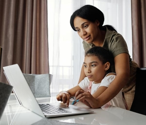 A mother helping their child with homework