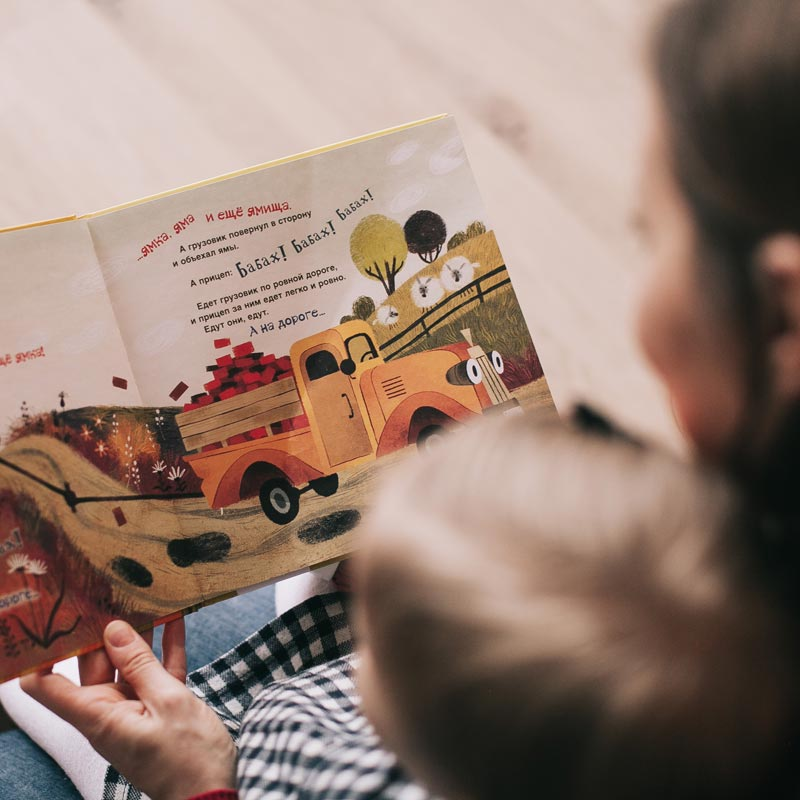 Mum reading with under-five child