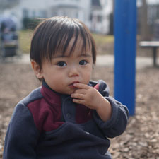 Toddler in play area