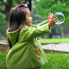 2 year old playing with bubbles