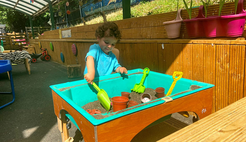 A child in the plant potting area